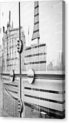 Glass Panels And Reflections Canvas Print by Tom Gowanlock