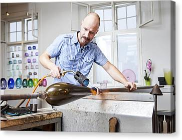 Glassblower At Work Canvas Print by Thomas Fredberg