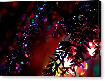 Glittery Light Reflecting On Ice Covered Branches Canvas Print by Mela Luna