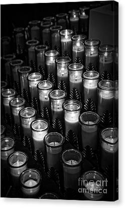 Glowing Candles In A Church Canvas Print by Edward Fielding