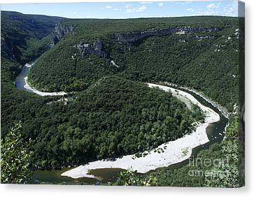 Going Down Ardeche River On Canoe. Ardeche. France Canvas Print by Bernard Jaubert