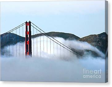 Golden Gate Bridge Clouds Canvas Print by Tap On Photo