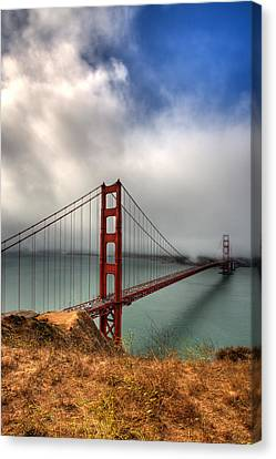 Golden Gate In The Clouds Canvas Print by Peter Tellone