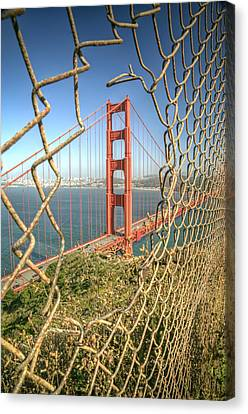 Golden Gate Through The Fence Canvas Print by Scott Norris