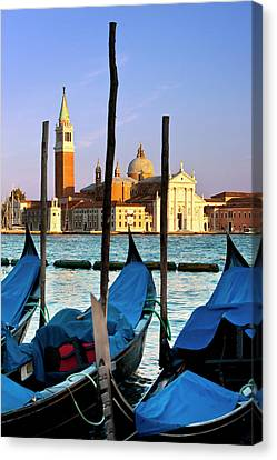 Gondolas Moored Across The Canal Canvas Print by Brian Jannsen