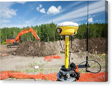 Gps Theodolite New House Building Canvas Print by Ashley Cooper
