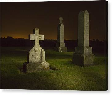 Gravestones At Night Painted With Light Canvas Print by Jean Noren