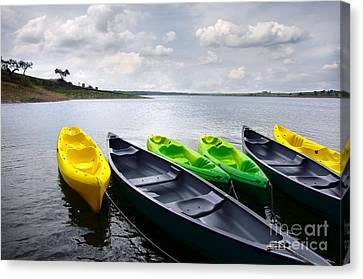 Green And Yellow Kayaks Canvas Print by Carlos Caetano