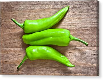 Green Jalapeno Peppers Canvas Print by Tom Gowanlock