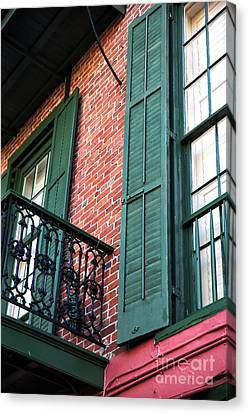 Green Shutters In The Quarter Canvas Print by John Rizzuto