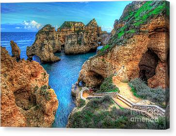 Grottos At Ponta Piedade Canvas Print by English Landscapes