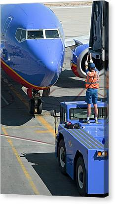Ground Crew Directing Jet Airliner Canvas Print by Jim West