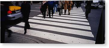 Group Of People Crossing At A Zebra Canvas Print by Panoramic Images