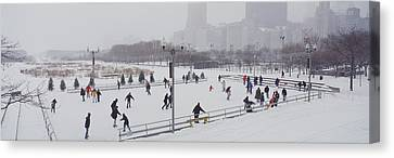 Group Of People Ice Skating In A Park Canvas Print by Panoramic Images