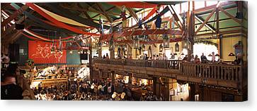 Group Of People In The Oktoberfest Canvas Print by Panoramic Images