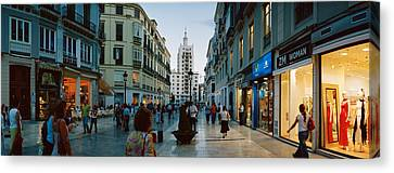 Group Of People Walking On A Street Canvas Print by Panoramic Images