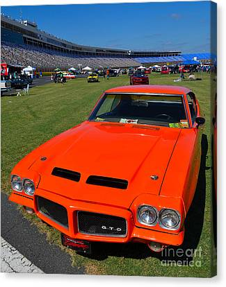 Gto At The Racetrack Canvas Print by Mark Spearman