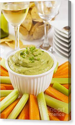 Guacamole With Carrot And Celery Sticks Canvas Print by Colin and Linda McKie