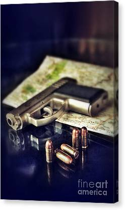 Gun With Bullets And Map Canvas Print by Jill Battaglia