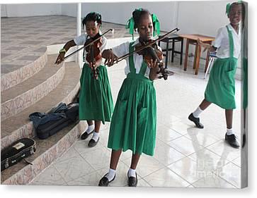 Haitian Girls Play Violins Canvas Print by Jim Wright