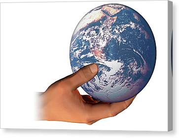 Hand Holding The Earth Canvas Print by Carol & Mike Werner
