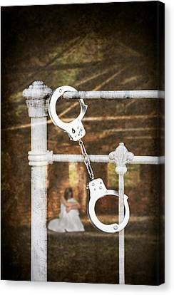 Handcuffs On Bed Canvas Print by Amanda And Christopher Elwell