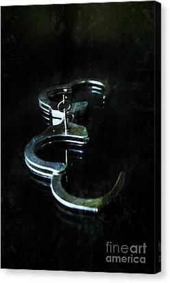 Handcuffs On Black Canvas Print by Jill Battaglia