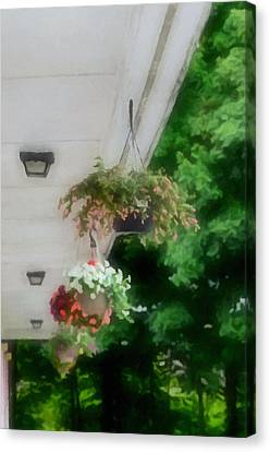 Hanging Flower Baskets On A Porch  Canvas Print by Lanjee Chee