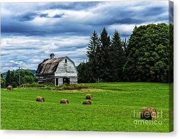 Hay Bales Barn Stormy Sky Canvas Print by Thomas R Fletcher