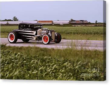 Headed To The Drags Canvas Print by Dennis Hedberg