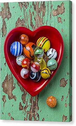 Heart Dish With Marbles Canvas Print by Garry Gay