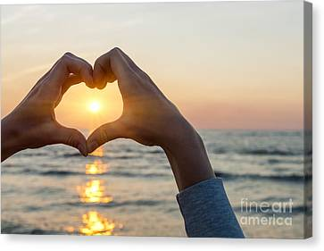 Heart Shaped Hands Framing Ocean Sunset Canvas Print by Elena Elisseeva