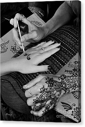 Henna Artist At Play Canvas Print by Jennie Breeze