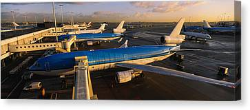 High Angle View Of Airplanes At An Canvas Print by Panoramic Images
