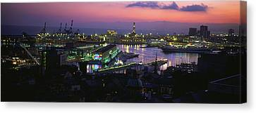 High Angle View Of City At A Port Lit Canvas Print by Panoramic Images
