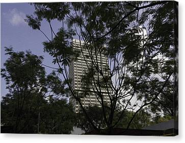 High Rise Buildings Behind Trees In Singapore Canvas Print by Ashish Agarwal