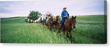 Historical Reenactment Of Covered Canvas Print by Panoramic Images