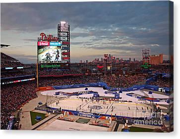 Hockey At The Ballpark Canvas Print by David Rucker