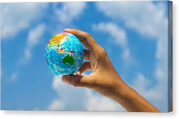 Holding A Globe Canvas Print by Aged Pixel