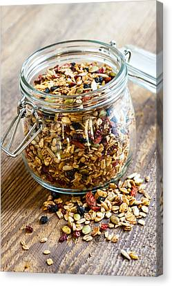 Homemade Granola In Glass Jar Canvas Print by Elena Elisseeva