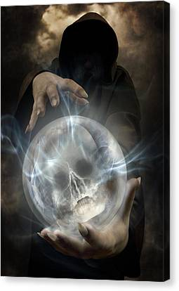 Hooded Man Wearing Dark Cloak Holding Glowing Crystall Ball With Human Skull Image Inside Canvas Print by Jaroslaw Blaminsky