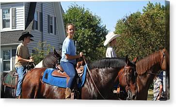 Horseback Riders Canvas Print by Carolyn Ricks