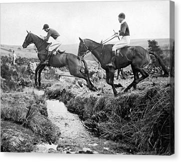 Horses Jumping A Creek Canvas Print by Underwood Archives