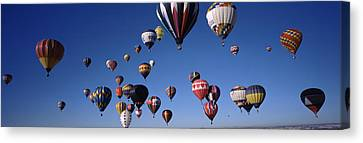 Hot Air Balloons Floating In Sky Canvas Print by Panoramic Images