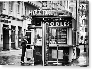 Hot Dogs Or Noodles Canvas Print by John Rizzuto