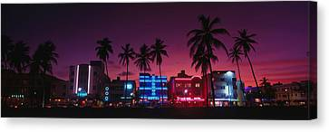 Hotels Illuminated At Night, South Canvas Print by Panoramic Images