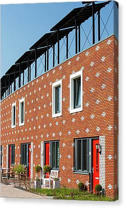 Houses In Almere With Solar Pv Panels Canvas Print by Ashley Cooper