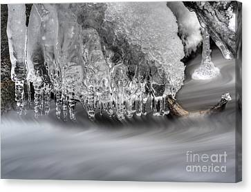 Ice Formation Above Stream Canvas Print by Dan Friend