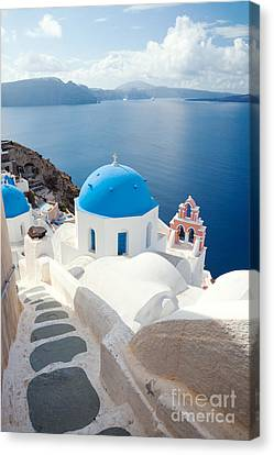 Iconic Blue Domed Churches In Santorini - Greece Canvas Print by Matteo Colombo