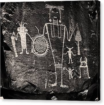 Iconic Petroglyphs From The Freemont Culture Canvas Print by Melany Sarafis